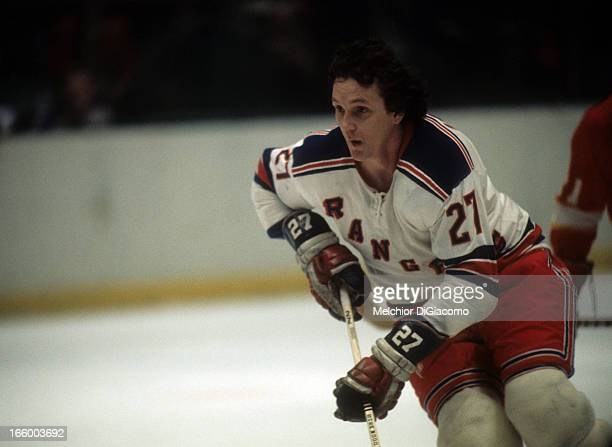 Ted Irvine of the New York Rangers skates on the ice during an NHL game against the Detroit Red Wings circa 1972 at the Madison Square Garden in New...