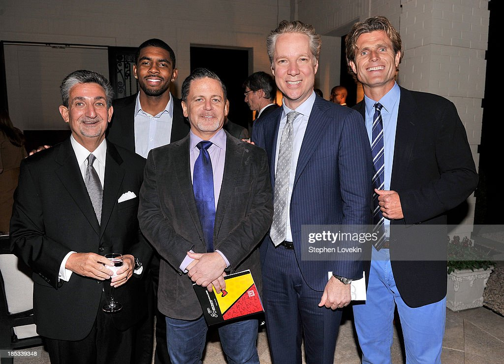 <a gi-track='captionPersonalityLinkClicked' href=/galleries/search?phrase=Ted+Leonsis&family=editorial&specificpeople=2248725 ng-click='$event.stopPropagation()'>Ted Leonsis</a>, <a gi-track='captionPersonalityLinkClicked' href=/galleries/search?phrase=Kyrie+Irving&family=editorial&specificpeople=6893971 ng-click='$event.stopPropagation()'>Kyrie Irving</a>, Dan Gilbert, Scott Keogh, and Anthony Kennedy Shriver, Founder and Chairman of Best Buddies International, attend a reception hosted by Ted and Lynn Leonsis celebrating the 2013 Audi Best Buddies Challenge: Washington, DC on October 18, 2013 in Potomac, Maryland.