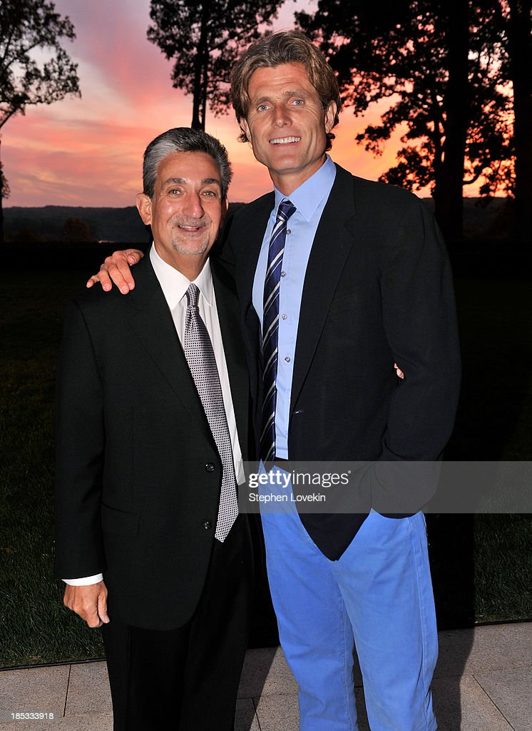 Ted Leonsis, Owner of the Washington Capitals, Washington Wizards, and the Verizon Center, and Anthony Kennedy Shriver, Founder and Chairman of Best Buddies International, attend a reception hosted by Ted and Lynn Leonsis celebrating the 2013 Audi Best Buddies Challenge: Washington, DC on October 18, 2013 in Potomac, Maryland.