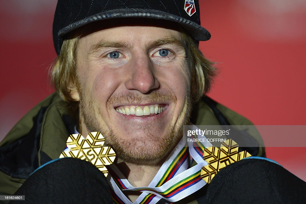 US Ted Ligety holds two gold medals during the podium ceremony after the men's Super Combined event of the 2013 Ski World Championships in Schladming on February 13, 2013. Ligety won the super combined event to add to the super-G title he claimed earlier in the championships. AFP PHOTO / FABRICE COFFRINI