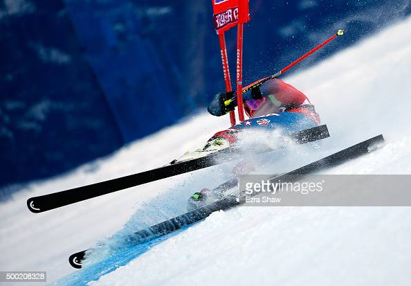 Ted Ligety of the United States crashes into a gate during the first run of the Audi FIS Ski World Cup Giant Slalom race on the Birds of Prey on...