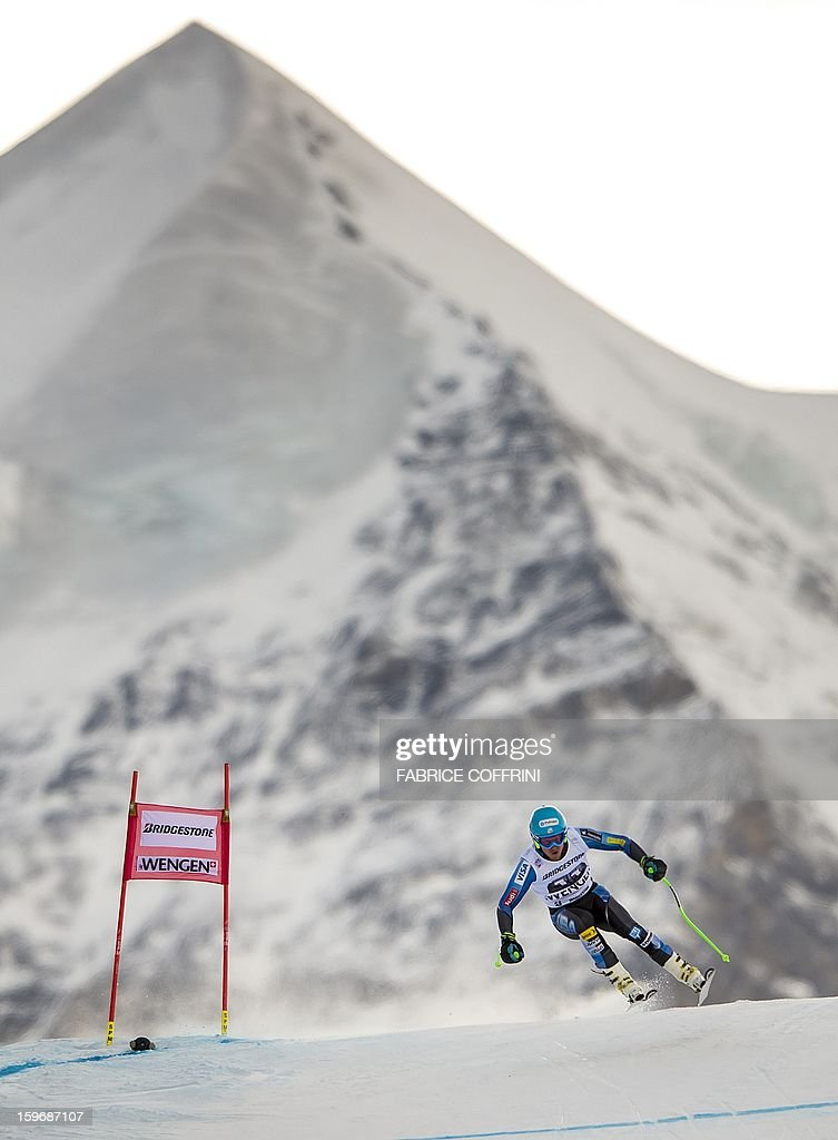 Ted Ligety of the United States leaps on January 18, 2013 in front of the Silberhorn mountain during the downhill event of the men's super combined of the FIS Alpine Skiing World Cup in Wengen. AFP PHOTO / FABRICE COFFRINI