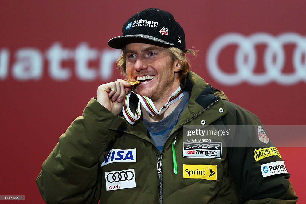 Ted Ligety of the United States of America celebrates at the medal ceremony after winning gold in the Men's Giant Slalom during the Alpine FIS Ski World Championships on February 15, 2013 in Schladming, Austria.