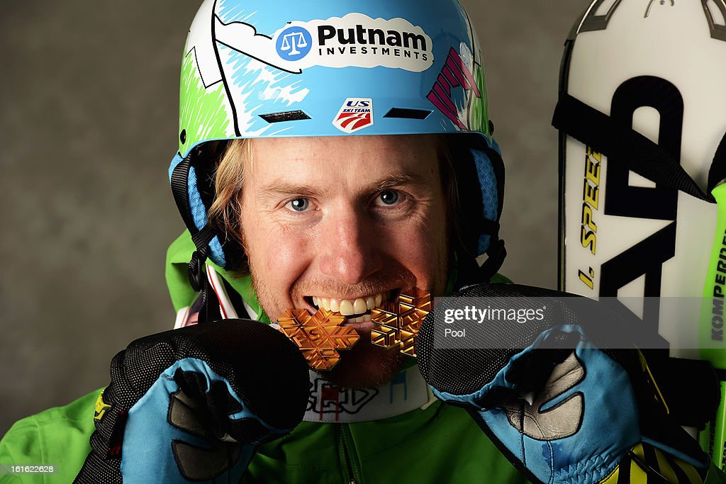 Ted Ligety of the United States of America celebrates with his gold medals for winning the Men's Super Combined and the Men's Super G events during the Alpine FIS Ski World Championships on February 13, 2013 in Schladming, Austria.