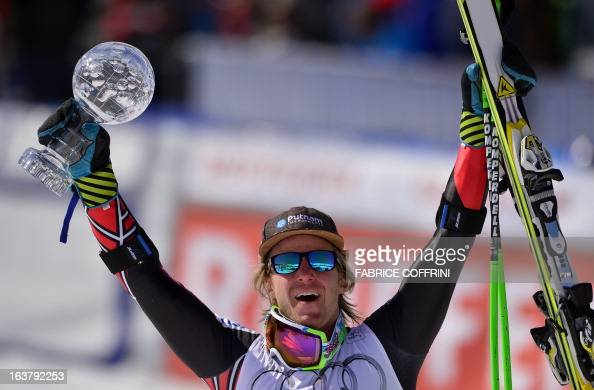 Ted Ligety of the US celebrates after winning the Men Giant Slalom race and the Crystal Globe Trophy at the Alpine ski World Cup finals on March 16...