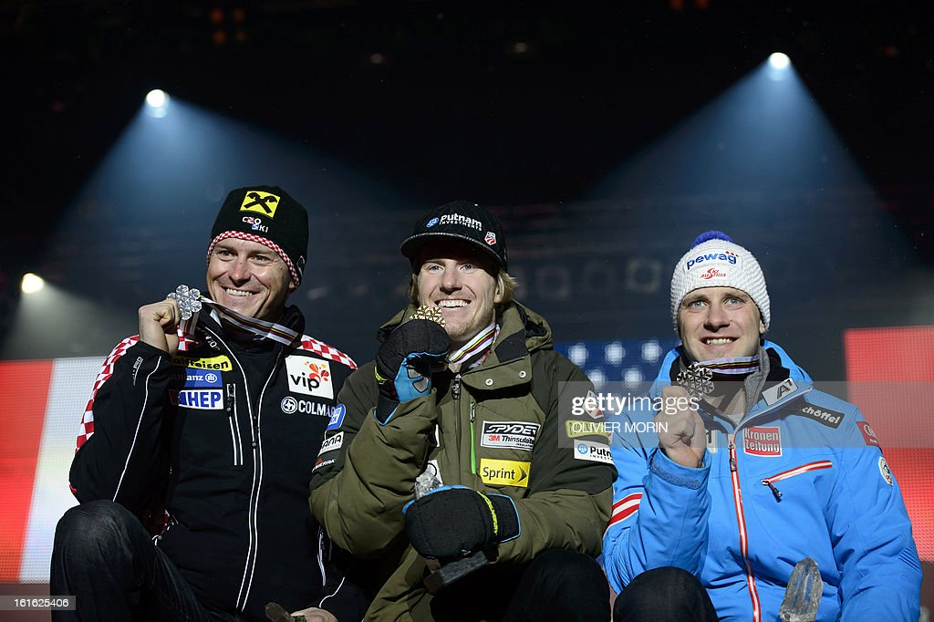 Ted Ligety (C) of the US poses with his gold medal next to Croatia's silver medalist Ivica Kostelic and Austria's bronze medalist Romed Baumann (R) during the medals ceremony after winning the men's combined event of the 2013 Ski World Championships in Schladming,on February 13, 2013.