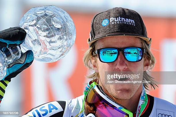 Ted Ligety of the USA takes the globe for the overall World Cup Giant slalom during the Audi FIS Alpine Ski World Cup Men's Giant Slalom on March 16...