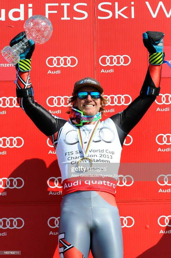 <a gi-track='captionPersonalityLinkClicked' href=/galleries/search?phrase=Ted+Ligety&family=editorial&specificpeople=580537 ng-click='$event.stopPropagation()'>Ted Ligety</a> of the USA takes the globe for the overall World Cup Giant slalom during the Audi FIS Alpine Ski World Cup Men's Giant Slalom on March 16, 2013 in Lenzerheide, Switzerland.