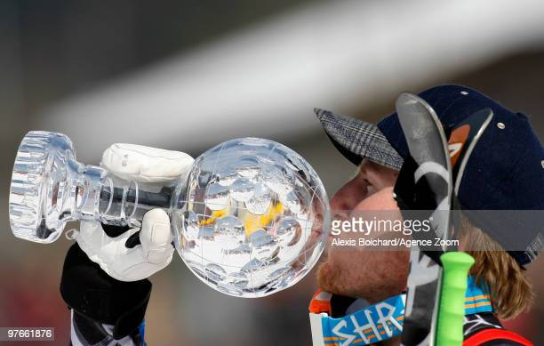 Ted Ligety of the USA takes the globe for the overall World Cup Giant slalom during the Audi FIS Alpine Ski World Cup Men's Giant Slalom on March 12...