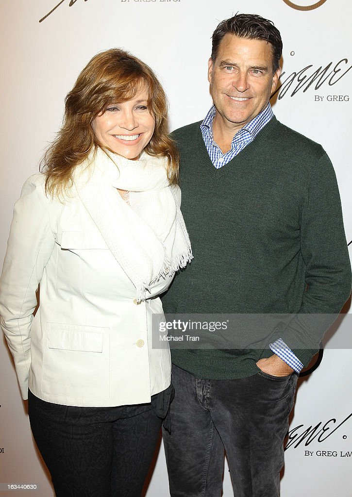 <a gi-track='captionPersonalityLinkClicked' href=/galleries/search?phrase=Ted+McGinley&family=editorial&specificpeople=210643 ng-click='$event.stopPropagation()'>Ted McGinley</a> (R) and guest arrive at the 2013 Los Angeles Fashion Week - The House Of Irene Autumn/Winter 2013 fashion show held at Raleigh Studios on March 9, 2013 in Los Angeles, California.
