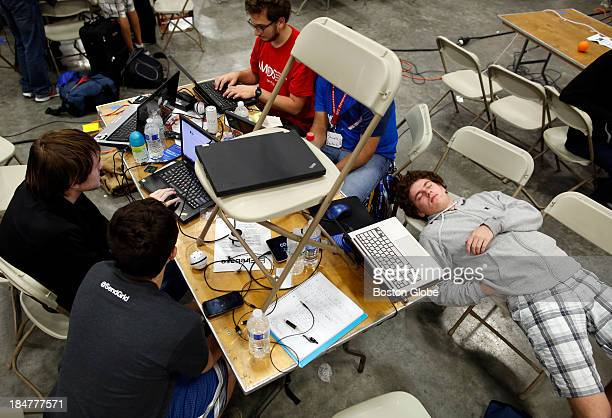 Ted Meyer who attends Worcester Polytechnic Institute bottom right sleeps as his team works on a hack that would allow an image to be parsed into...