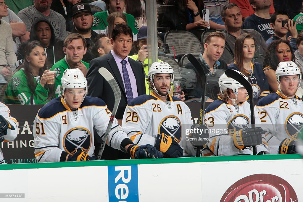 Ted Nolan head coach of the Buffalo Sabres watches the action from behind the bench against the Dallas Stars at the American Airlines Center on March...