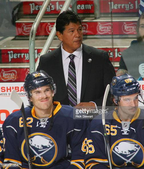 Ted Nolan stands on the bench in his first game back as interim head coach of Buffalo Sabres against the Toronto Maple Leafs at First Niagara Center...