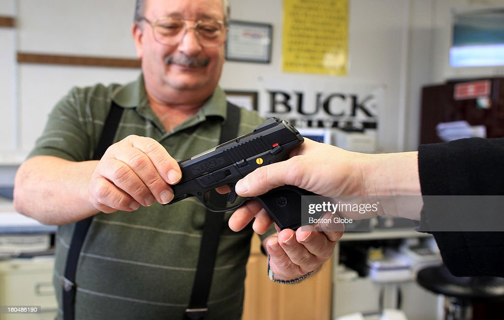 Ted Oven, owner of Northeast Trading Co., Inc., has had a hard time keeping guns in stock because of the skyrocketing demand. Ted shows a customer a Ruger SR9C hand gun that had just arrived in store.