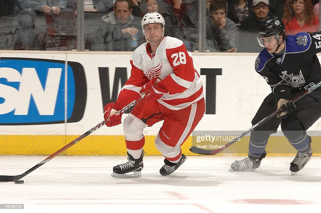 Ted Percell #54 of the Los Angeles Kings skates against Brian Rafalski #28 of the Detroit Red Wings on January 22, 2008 at the Staples Center in Los Angeles, California