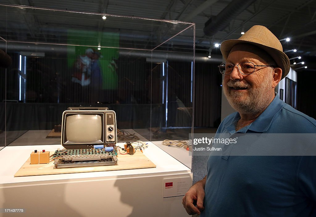 Ted Perry stands next to his Apple-1 computer during the First Bytes: Iconic Technology From the Twentieth Century, an online auction featuring vintage tech products at the Computer History Museum on June 24, 2013 in Mountain View, California. Christie's is auctioning off an original Apple-1 computer owned by Ted Perry as part of its First Bytes: Iconic Technology from the Twentieth Century, an online auction of vintage tech products. The online auction begins today and runs through July 9. The Apple-1 is expected to fetch between $300,000 and $500,000.