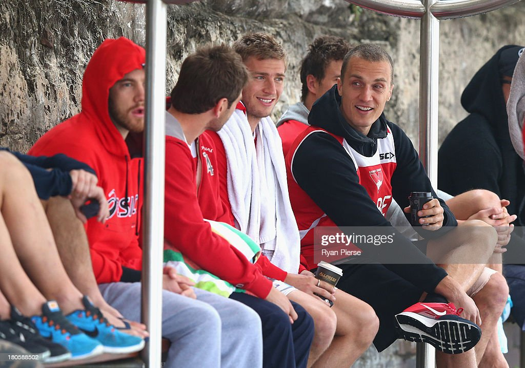 Ted Richards and Kieren Jack of the Swans look on during a recovery session at Coogee Beach on September 15, 2013 in Sydney, Australia.