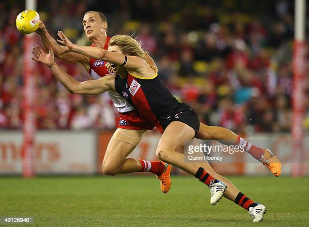 Ted Richards of the Swans spoils a mark by Dyson Heppell of the Bombers during the round nine AFL match between the Essendon Bombers and the Sydney...