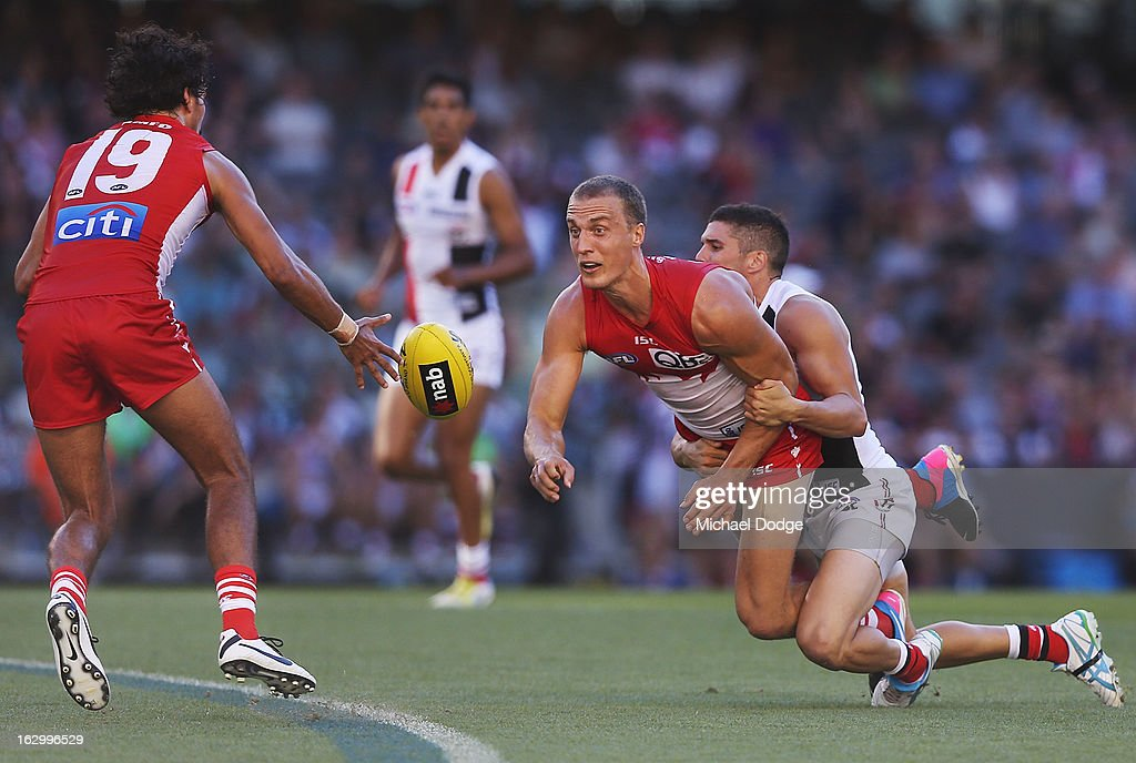 Ted Richards of the Sydney Swans handpasses the ball to Tony Armstrong during the round two AFL NAB Cup match between the St Kilda Saints and the Sydney Swans at Etihad Stadium on March 3, 2013 in Melbourne, Australia.