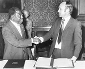 Ted Rowlands British Minister of State shaking hands with LouisAntoine Aduko Ambassador of the Ivory Coast at the Foreign Office in London December...