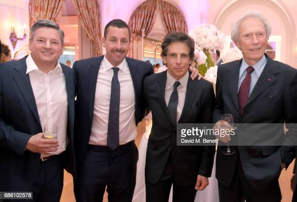 Ted Sarandos Adam Sandler Ben Stiller and Clint Eastwood attend the Vanity Fair and HBO Dinner celebrating the Cannes Film Festival at Hotel du...