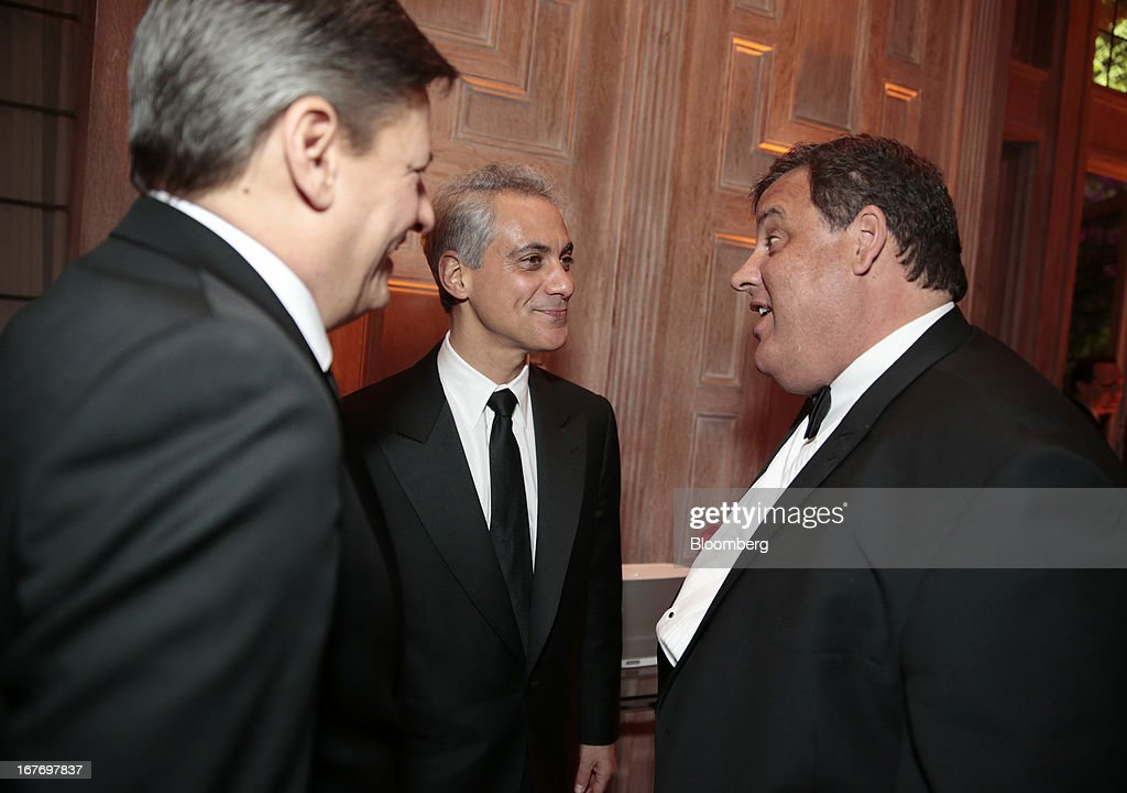 Ted Sarandos, chief content officer for Netflix Inc., from left, Chicago Mayor Rahm Emanuel, and Governor Chris Christie, a Republican from New Jersey, attend the Bloomberg Vanity Fair White House Correspondents' Association (WHCA) dinner afterparty in Washington, D.C., U.S., on Saturday, April 27, 2013. The 99th annual dinner raises money for WHCA scholarships and honors the recipients of the organization's journalism awards. Photographer: Andrew Harrer/Bloomberg via Getty Images
