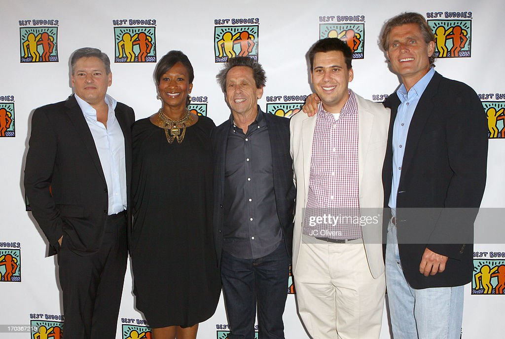 Ted Serandos, Nicole Avant, <a gi-track='captionPersonalityLinkClicked' href=/galleries/search?phrase=Brian+Grazer&family=editorial&specificpeople=203009 ng-click='$event.stopPropagation()'>Brian Grazer</a>, Riley Grazer and <a gi-track='captionPersonalityLinkClicked' href=/galleries/search?phrase=Anthony+Shriver&family=editorial&specificpeople=727552 ng-click='$event.stopPropagation()'>Anthony Shriver</a> attend Best Buddies Jobs Vanguard reception at UTA on June 11, 2013 in Beverly Hills, California.