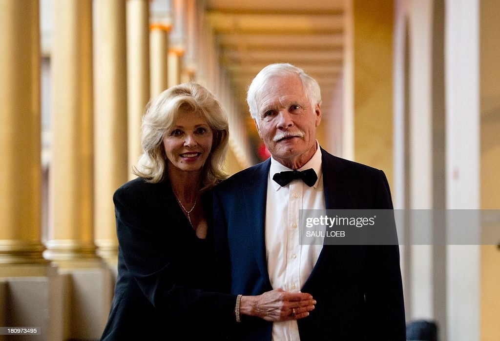 Ted Turner, founder of CNN, and Sally Ranney (L) arrive to attend the Lone Sailor Awards Dinner at the National Building Museum in Washington, DC, September 18, 2013. The award honors Sea Service veterans who have excelled in their civilian careers while exemplifying the Navy core values with this year's honorees being Turner, Dan Akerson, Chairman and CEO of General Motors, Marine Corps General P. X. Kelley and former US Senator Kay Bailey Hutchison. AFP PHOTO / Saul LOEB
