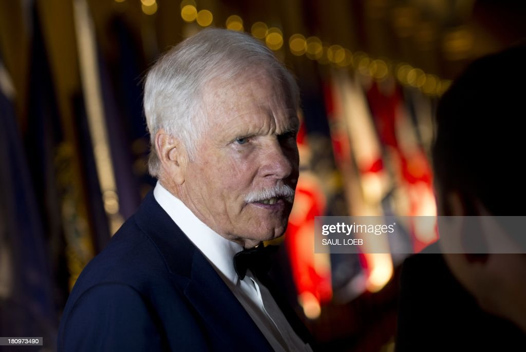 Ted Turner, founder of CNN, attends the Lone Sailor Awards Dinner at the National Building Museum in Washington, DC, September 18, 2013. The award honors Sea Service veterans who have excelled in their civilian careers while exemplifying the Navy core values with this year's honorees being Turner, Dan Akerson, Chairman and CEO of General Motors, Marine Corps General P. X. Kelley and former US Senator Kay Bailey Hutchison. AFP PHOTO / Saul LOEB