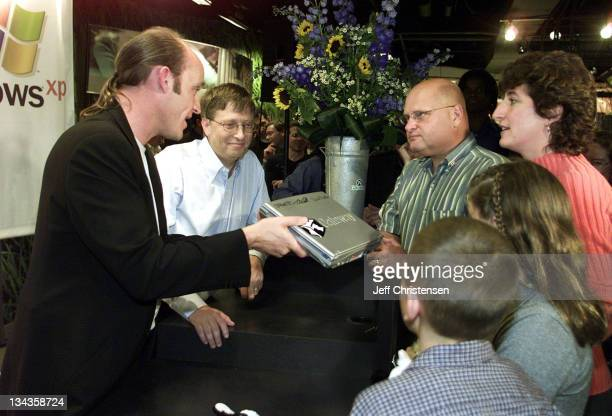 Ted Waitt CEO of Gateway Computers and Bill Gates Chairman and Chief Software Architect of Microsoft present a Gateway laptop computer with...