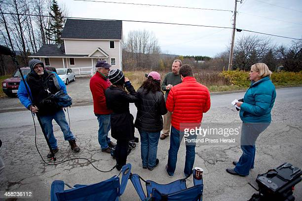 Ted Wilbur addresses the media outside his house in Fort Kent after a CDC worker revisited the house to retake Wilbur's girlfriend Kaci Hickox's...