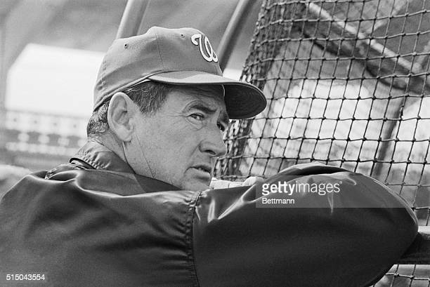 Ted Williams casts a critical look toward the infield as he leans against a batting practice cage during opening day of the Washington Senators...