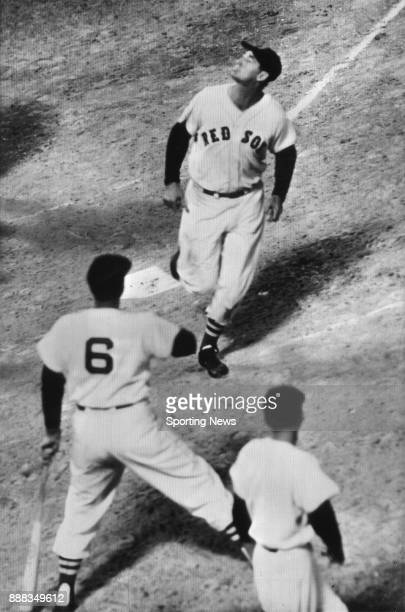 Ted Williams looks up toward the press box with lips puckered as if to spit after hitting the 400th home run of his Boston Red Sox career at Boston's...