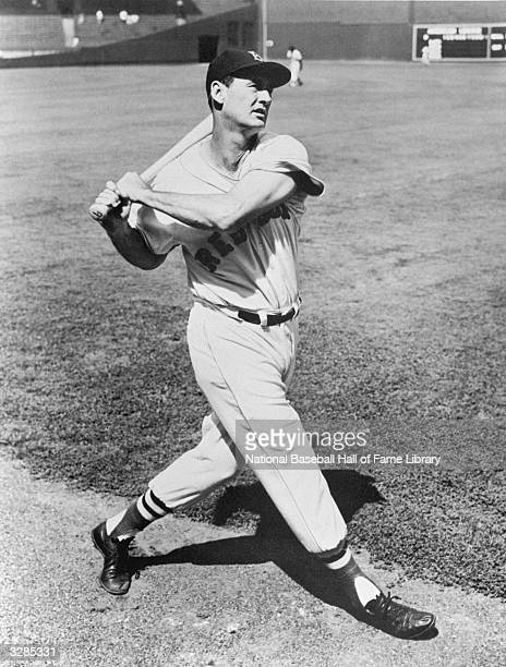 Ted Williams of the Boston Red Sox takes a practice swing Ted Williams played for the Boston Red Sox from 19391960