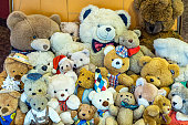 many teddy bears in a suitcase