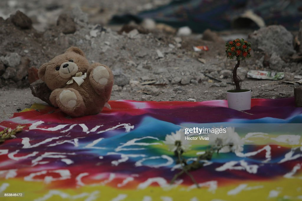 A teddy bear and flowers are seen in the collapsed sewing factory at Colonia Obrera six days after the magnitude 7.1 earthquake jolted central Mexico killing more than 300 hundred people, damaging buildings, knocking out power and causing alarm throughout the capital on September 25, 2017 in Mexico City, Mexico.