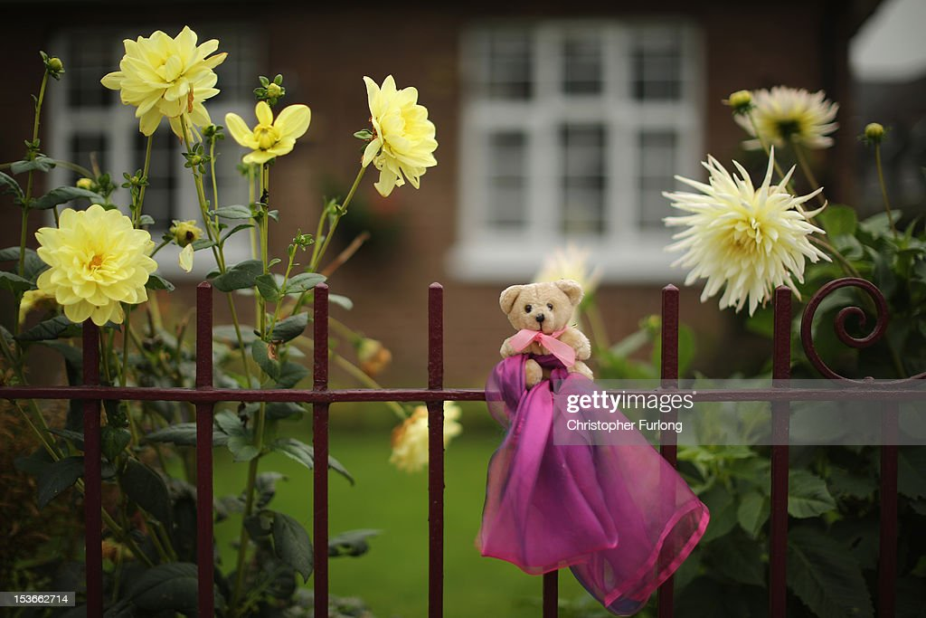 A teddy bear, and pink ribbon the symbol of 'Find April' sits on a garden fence as police continue their search to find five-year-old April Jones on October 8, 2012 in Machynlleth, Wales. April Jones was abducted from outside her house last week in Machynlleth mid Wales. Local man Mark Bridger appeared before magistrates earlier today charged with her murder, abduction and perverting the course of justice.