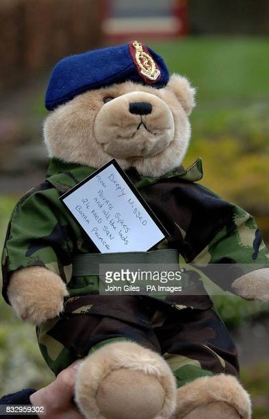 A teddy bear dressed as an Army Medic from fellow medics serving in Basra Iraq is carried at the Military Funeral of Corporal Kris O'Neill which took...