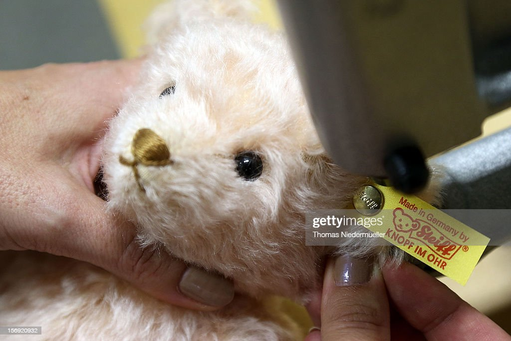A teddy bear has the company logo pinned to its ear at the Steiff stuffed toy factory on November 23 2012 in Giengen an der Brenz Germany Founded by...