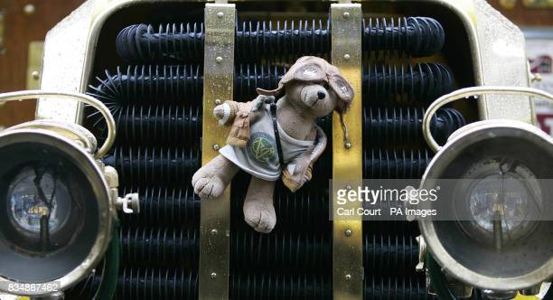 A teddy bear is tied to the front of a vintage car on Regents Street London to mark the launch of the London to Brighton Veteran Car Run this Sunday