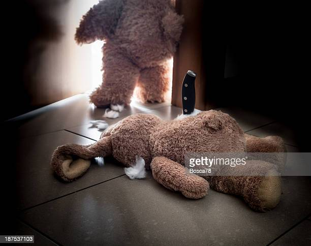 Fantasy reconstruction of the crime scene of a rabbit peluche killed by a teddy bear. Vintage look.