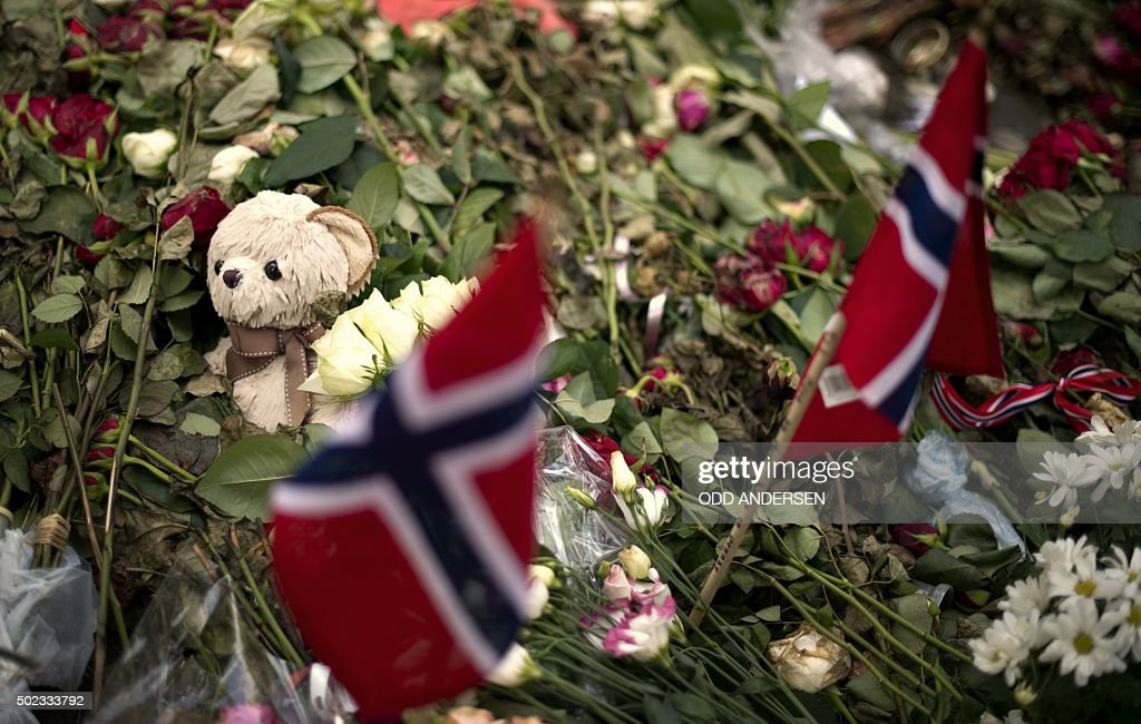 A teddy bear lies among flower tributes to the victims of an attack on government buildings and massacre on the youth camp of the Norwegian Labour...