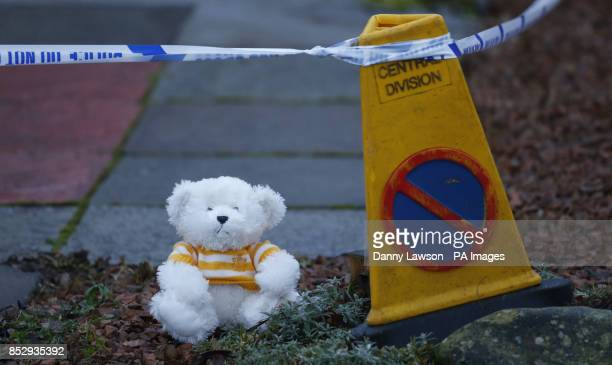 A teddy bear placed outside a house in Kirkcaldy Scotland after a child's body believed to be that of missing 3 year old Mikaeel Kular has been found