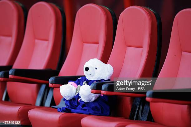 A teddy bear representing the injured player Kozue Ando of Japan sits on the Japan bench during the FIFA Women's World Cup 2015 Group C match between...