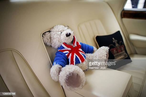 A teddy bear sits on the back seat of a classic Rolls Royce car before a centenary parade on February 6 2011 in London England Rolls Royce is...