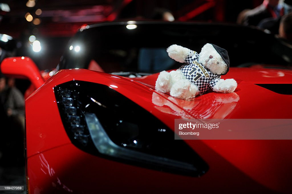 A teddy bear sits on top of the 2014 Chevrolet Corvette Stingray after the unveiling ahead of the 2013 North American International Auto Show (NAIAS) in Detroit, Michigan, U.S., on Sunday, Jan. 13, 2013. The new model, set to reach dealers in this year's third quarter, is part of the push to breathe new life into the Chevy brand, which accounted for 71 percent of GM's 2012 U.S. sales. Photographer: Daniel Acker/Bloomberg via Getty Images