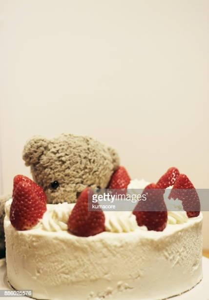 Teddy bear to aim at a cake