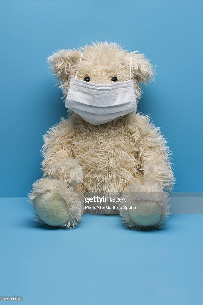 Teddy bear wearing flu mask