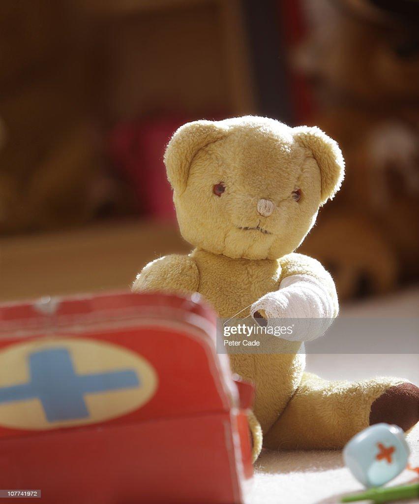 teddy bear with bandaged arm : Stock Photo