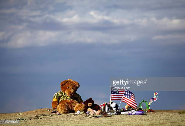 Teddy bears are seen as part of a memorial across the street from the Century 16 movie theatre July 25 2012 in Aurora Colorado Twentyfouryearold...